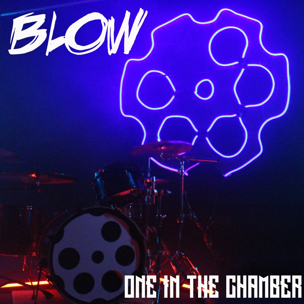 Drum kit and neon logo for One in the Chamber