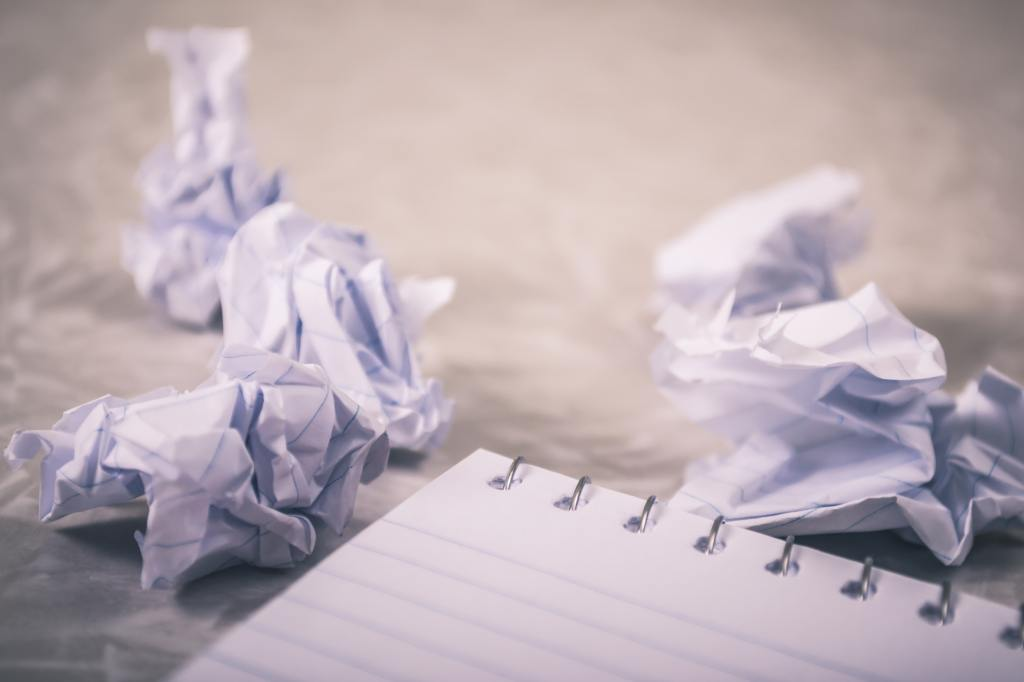 Crumpled paper in front of blank pages