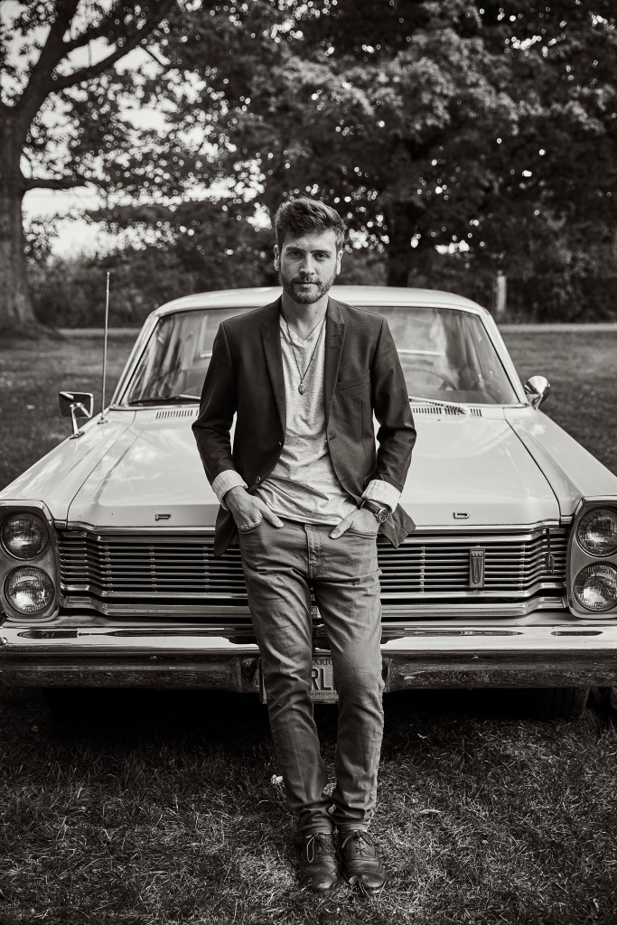 Kyler Tapscott in front of a classic car