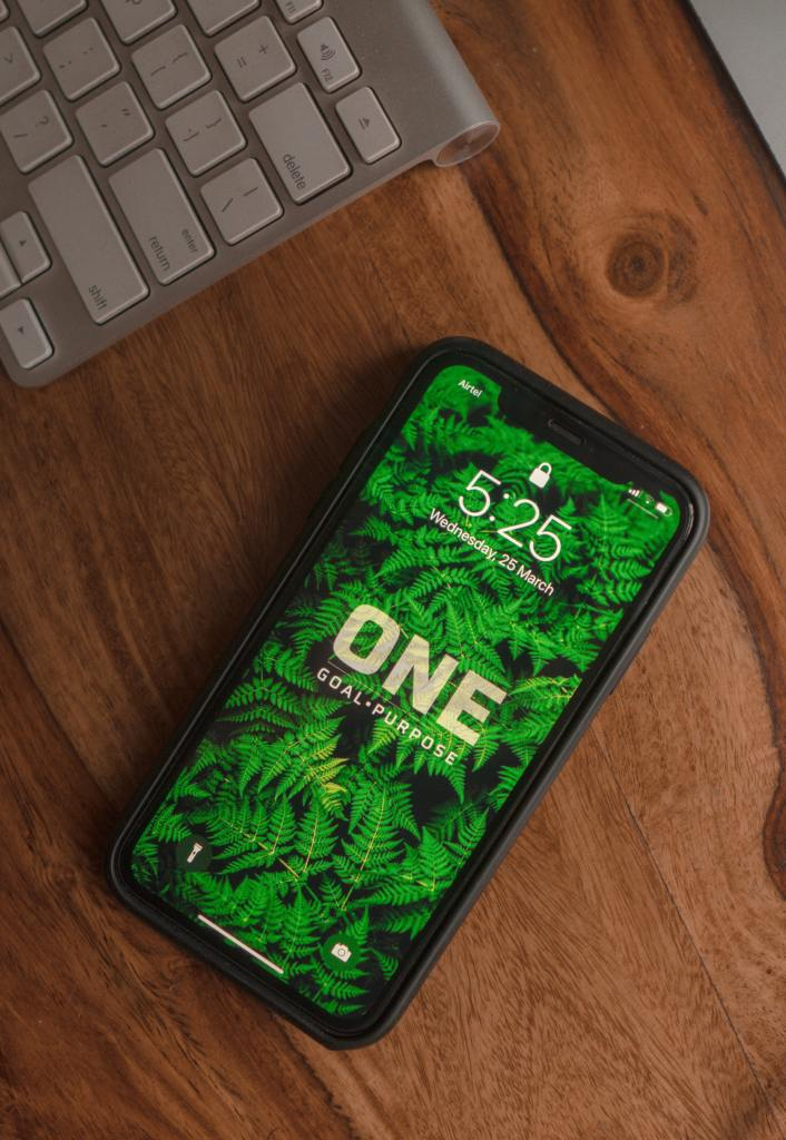 Cell phone depicting message one goal and purpose
