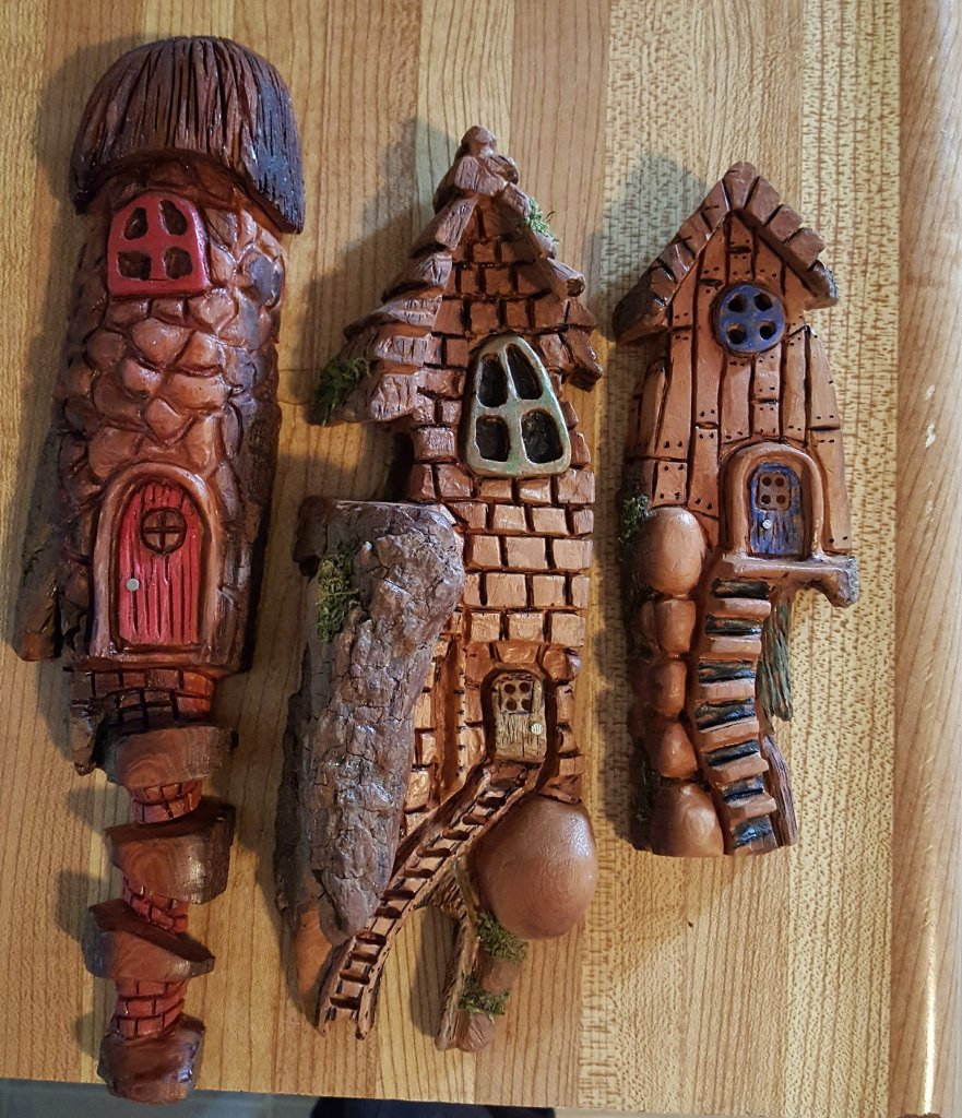 Three elaborate wood carved fantasy houses