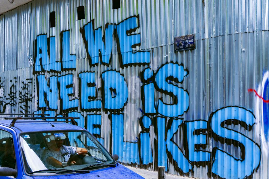 All we need is more likes spray painted to side of wall