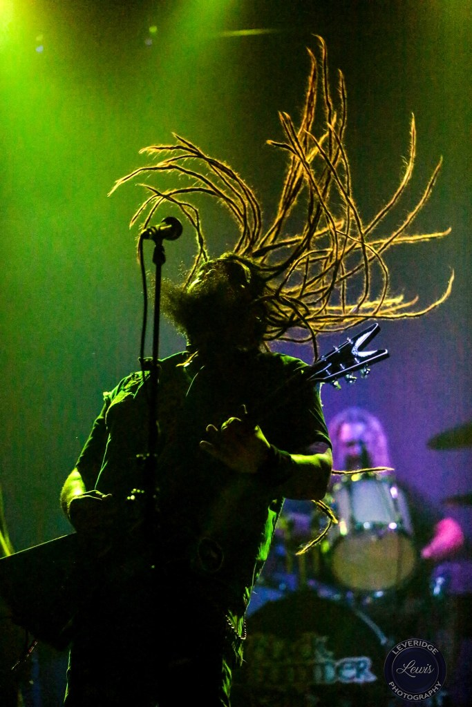 Rebel Few singer guitar player Chris Raposo silhouette on stage with hair flying