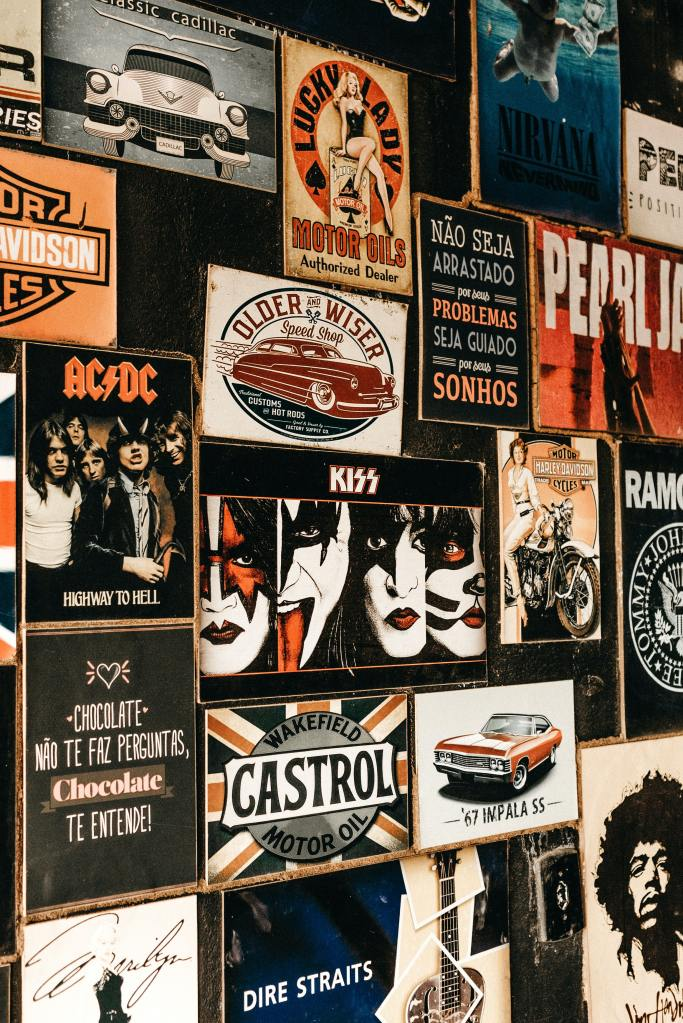 Wall of band posters - KISS, AC/DC, Ramones, Nirvana, Pearl Jam, Jimi Hendrix, Dire Straits